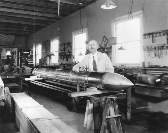 Dr. Robert Goddard with a rocket in his workshop at Roswell, New Mexico, in October 1935.
