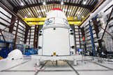 The Space Exploration Technologies, or SpaceX, Dragon spacecraft with solar array fairings attached, stands inside a processing hangar at Cape Canaveral Air Force Station, Fla. The spacecraft will launch on the upcoming SpaceX CRS-2 mission. Image released Jan. 15, 2013.