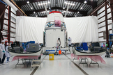 Workers prepare solar array fairings at the processing hangar used by Space Exploration Technologies, or SpaceX, at Cape Canaveral Air Force Station, Fla. This image was released Jan. 12, 2013.