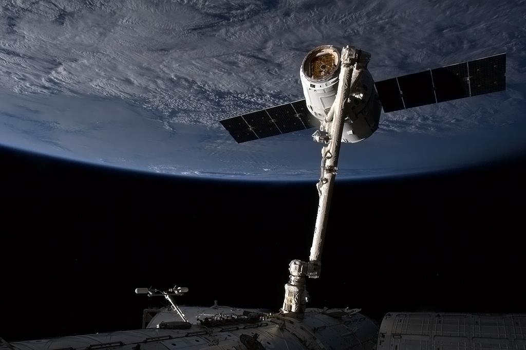 Dragon Captured by Space Station Robotic Arm