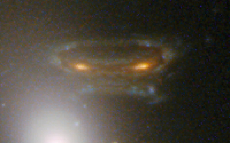 Gravitationally Lensed Image of Distant Galaxy in Abell 68