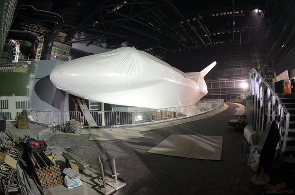 Since entering its six-story exhibit building at NASA's Kennedy Space Center Visitor Complex in Florida in November 2012, space shuttle Atlantis has been raised off the ground, shrink-wrapped in 16,000 square feet of plastic and tilted 43 degrees, the latter designed to give guests a view of what the shuttle looked like to astronauts aboard the International Space Station.
