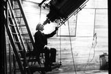 In a historical photo, Percival Lowell looks through the Clark telescope at Lowell Observatory, Flagstaff, Arizona. File photo undated.