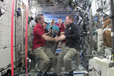 Canadian astronaut Chris Hadfield (left) accepts command of the International Space Station from NASA astronaut and out-going station commander Kevin Ford, March 13, 2013.