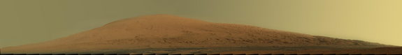 This mosaic of images from the Mast Camera (Mastcam) on NASA's Mars rover Curiosity shows Mount Sharp in raw color as recorded by the camera. Raw color shows the scene's colors as they would look in a typical smart-phone camera photo, before any adjustment. The component images were taken during the 45th Martian day, or sol, of Curiosity's mission on Mars (Sept. 20, 2012). Image released March 15, 2013.
