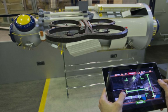 A free ESA app turns a popular iPhone-controlled 'home drone' into a spacecraft. The augmented reality game lets owners of Parrot AR.Drone quadcopters attempt dockings with a simulated International Space Station while flying their drones for real – in the process helping to improve robotic rendezvous methods. This new AstroDrone app is part of a scientific crowdsourcing project by ESA's Advanced Concepts Team, gathering data to teach robots to navigate their environments.
