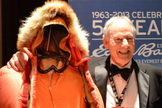 Jim Whittaker, the first American to climb to the top of Mount Everest, poses with the gear he wore on that expedition at the 2013 Explorers Club dinner.