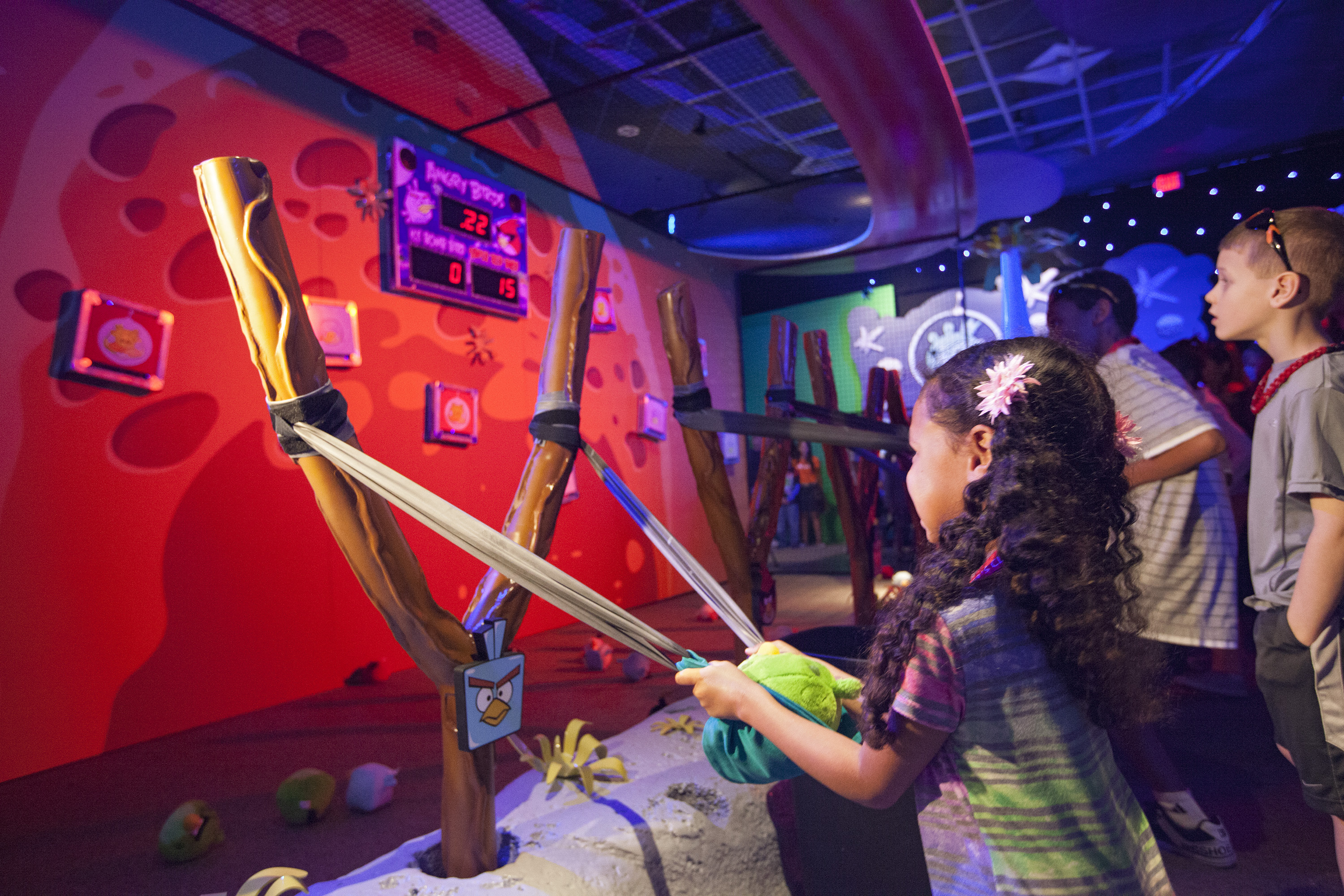Children Take Aim at Angry Birds Space Encounter Exhibit