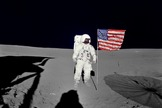 Ed Mitchell stands with the U.S. flag that he and Alan Shepard planted on the moon.