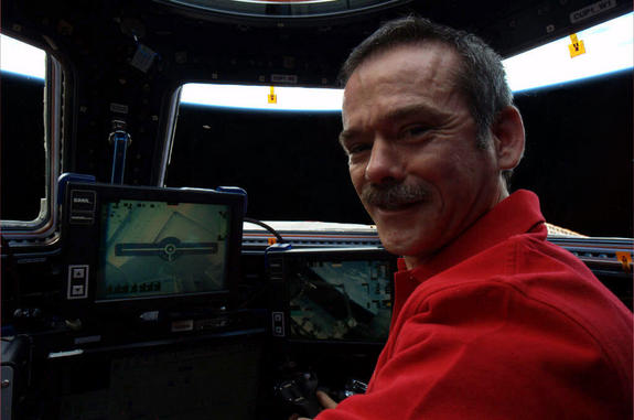 "Canadian astronaut Chris Hadfield ""spots"" a UFO in the distance: ""The view from where we fly the Canadarm2, with some orbital debris off in the distance,"" he wrote on Twitter."