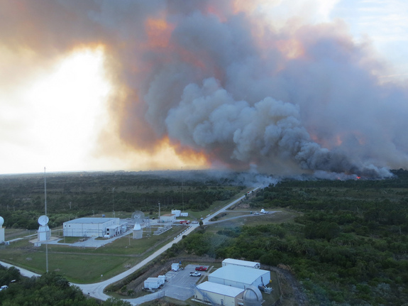 Additional NASA facilities that were protected during the second day of the Center fire were a radar site, a launch tracking camera and the laser range. The fire occurred just south of NASA's Kennedy Space Center headquarters on Merritt Island in Audobon, Florida. This image was taken on April 2, 2013.