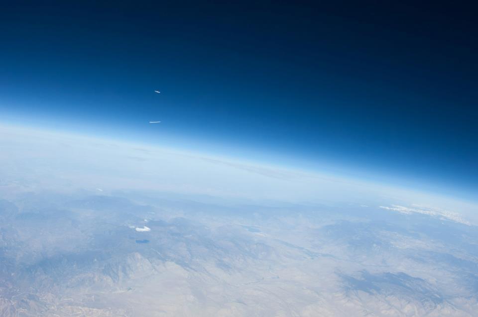 SpaceshipTwo in Flight Across Skies