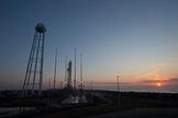 The sun rises over NASA's Wallops Flight Facility, where the first Antares rocket built by Orbital Sciences stands poised to launch on its test flight from Wallops Island on Virginia's Eastern Shore. Liftoff set for 5 pm ET on April 17, 2013.