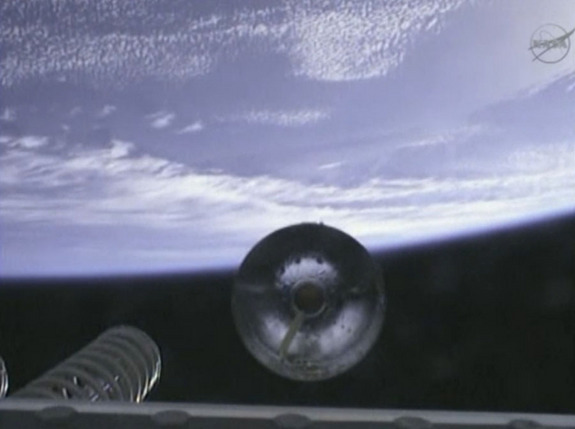 The first stage of Orbital Sciences' Antares rocket drops off during its April 21 launch, as seen from an onboard camera.