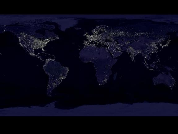 This composite image, which has become a popular poster, shows a global view of Earth at night, compiled from over 400 satellite images. NASA researchers have used these images of nighttime lights to study weather around urban areas.