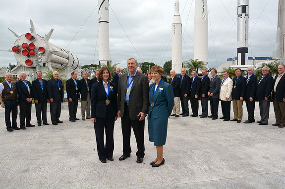 The 2013 class of U.S. Astronaut Hall of Fame inductees, Bonnie Dunbar (left), Curt Brown and Eileen Collins, are flanked by two dozen of their fellow Hall of Fame astronauts at the Kennedy Space Center Visitor Complex in Florida, April 20, 2013.
