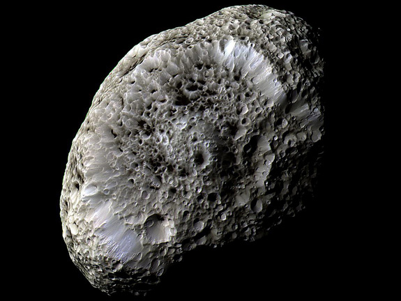 Saturn's moon, Hyperion, resembles a large sponge traveling through space. Its porous appearance raises questions about its composition.