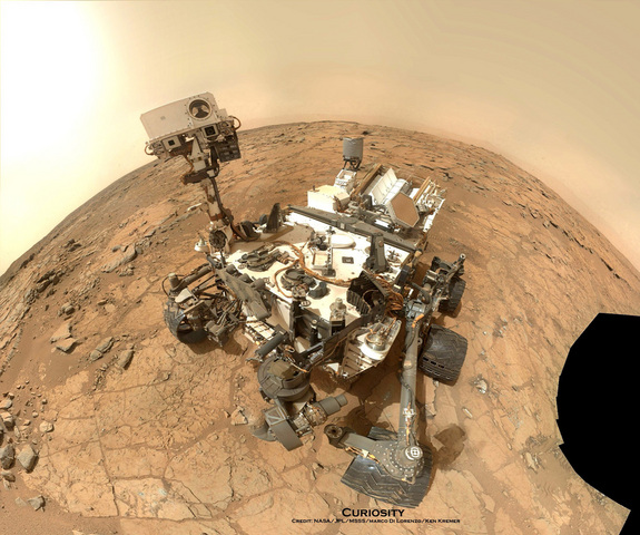 NASA's Mars rover Curiosity took this self-portrait, composed of more than 50 images using its robotic arm-mounted MAHLI camera, on Feb. 3, 2013. The image shows Curiosity at the John Klein drill site. A drill hole is visible at bottom left.