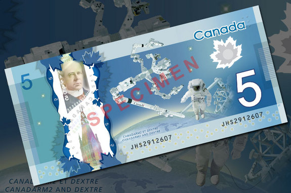 The Bank of Canada's new $5 bank note features a space-theme with the Canadarm2 robotic arm, Dextre manipulator and a spacewalking astronaut.