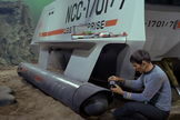 "Spock (Leonard Nimoy) surveys damage from Galileo's crash landing on planet Taurus II (episode ""The Galileo Seven"")"