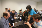 Manu Sharma (right, standing) assists Eric Dahlstrom (left) and Ryan Gillespie (right) in a hands-on exercise during the Space Hacker Workshop in Mountain View, Calif. in May 2013.