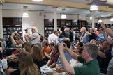 The crowd at Barnes & Noble in Union Square snaps photos of Aldrin, still a space rock star.