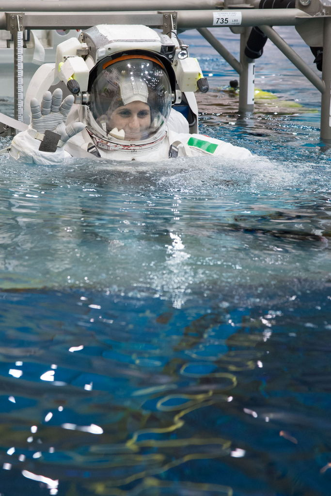 Astronauts Submerging in Waters of Neutral Buoyancy Laboratory