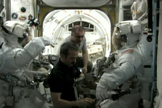 NASA astronauts Chris Cassidy and Tom Marshburn don their NASA-issue Extravehicular Mobility Units for an emergency spacewalk to find an ammonia link outside the International Space Station. Canadian astronaut Chris Hadfield (center) and Russian cosmonaut Pavel Vinogradov assist in the May 11, 2013 spacewalk work.