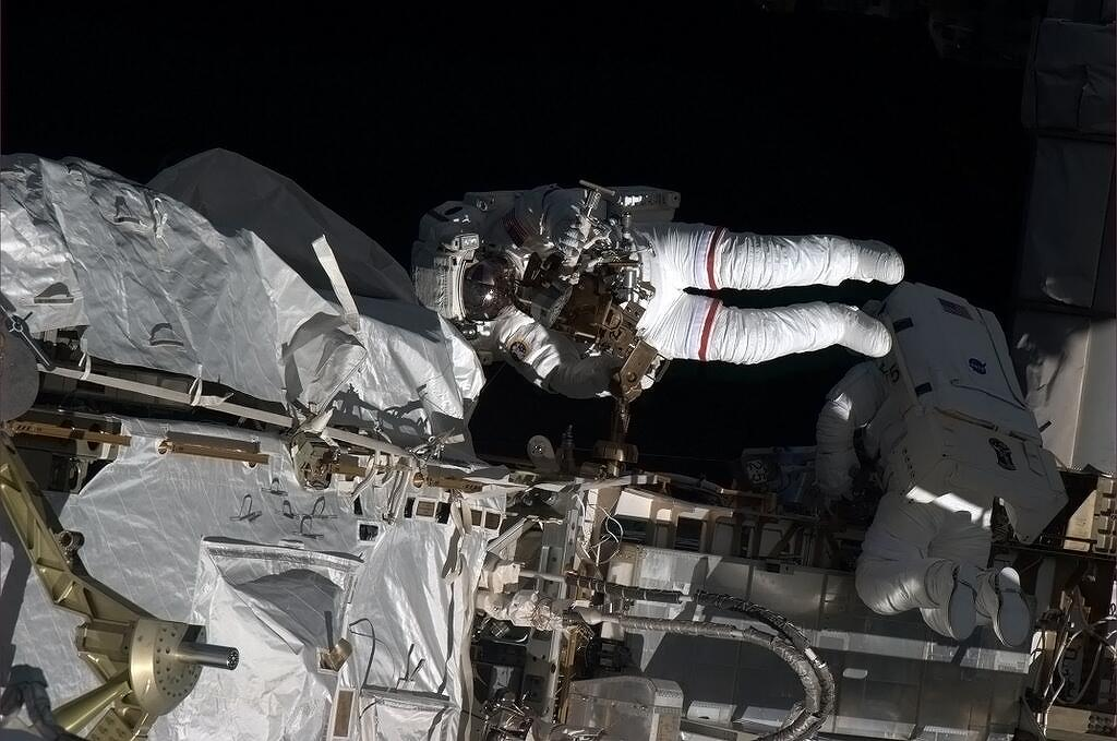Spacewalkers Approach Orbital Sunset
