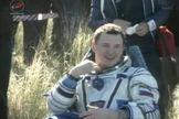 Soyuz commander Roman Romanenko, a Russian cosmonaut, smiles after being pulled from his Soyuz spacecraft following a smooth landing on May 14, 2013 (May 13 EDT) to end a five-month mission to the International Space Station.