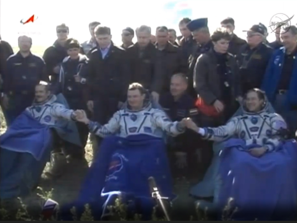 Soyuz Space Capsule Lands Safely with Crew of 3