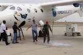 New Virgin Galactic pilot C.J. Sturckow, a four-time space shuttle astronaut, gets a traditional dousing after flying the company's WhiteKnightTwo mothership for the first time on May 9, 2013.