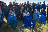 Expedition 35 Commander Chris Hadfield of the Canadian Space Agency (CSA), left, Russian Flight Engineer Roman Romanenko of the Russian Federal Space Agency (Roscosmos), center, and NASA Flight Engineer Tom Marshburn sit in chairs outside the Soyuz Capsule just minutes after they landed in a remote area outside the town of Dzhezkazgan, Kazakhstan, on Tuesday, May 14, 2013.