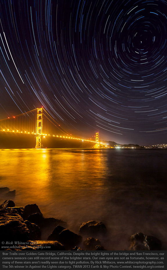 "Fifth place in the Against the Lights category goes to ""Golden Gate Star Trails"" by Rick Whitacre. A well-done photo sequence has captured star trails above the lights of San Fransisco and the Golden Gate Bridge."