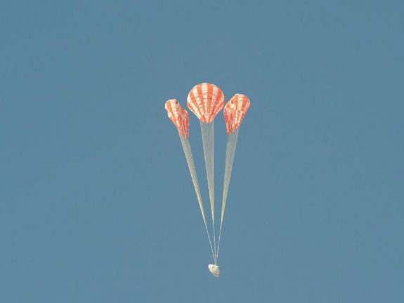 To test the Orion parachute system on May 1, 2013, engineers rigged one of the test capsule's three main parachutes – the middle parachute in this view – to skip one stage of its inflation, putting additional stress on the vehicle as it opened. Testing irregularities allows engineers to verify the parachutes are reliable even when something goes wrong.