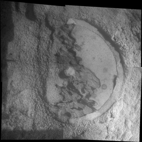 "This mosaic of four frames shot by the microscopic imager on the robotic arm of NASA's Mars Exploration Rover Opportunity shows a rock target called ""Esperance"" after some of the rock's surface had been removed by Opportunity's rock abrasion tool, or RAT."
