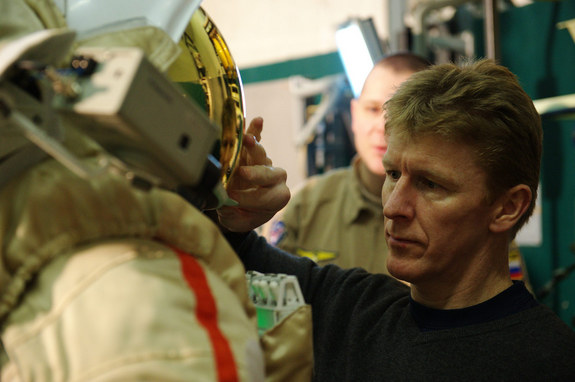 British astronaut Tim Peake works with a Russian Orlan spacesuit.