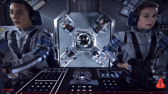 Astronauts work in their spacecraft cockpit in this still from the 2013 science fiction film 'Europa Report.'