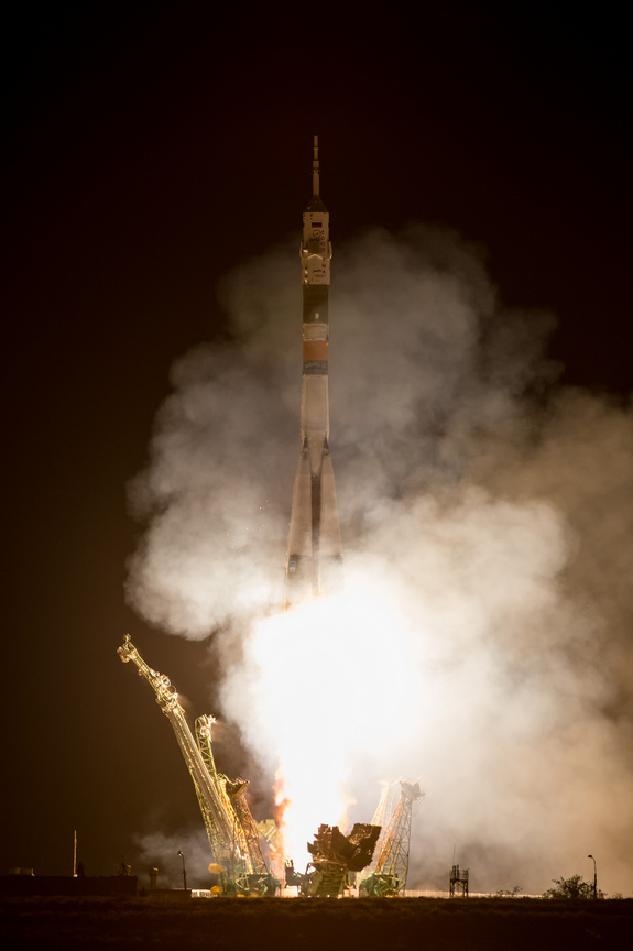 A Soyuz rocket with Expedition 36/37 Soyuz Commander Fyodor Yurchikhin of the Russian Federal Space Agency (Roscosmos), Flight Engineers: Luca Parmitano of the European Space Agency, center, and Karen Nyberg of NASA, onboard, launches from the Baikonur Cosmodrome in Kazakhstan to the International Space Station, Wednesday, May 29, 2013.