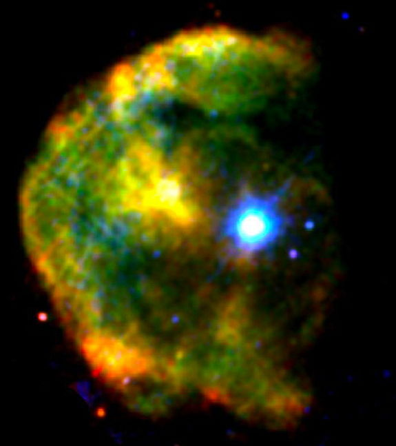 The magnetar 1E 2259+586 shines a brilliant blue-white in this false-color X-ray image of the CTB 109 supernova remnant, which lies about 10,000 light-years away toward the constellation Cassiopeia. X-rays at low, medium and high energies are respectively shown in red, green, and blue in this image created from observations acquired by the European Space Agency's XMM-Newton satellite in 2002.