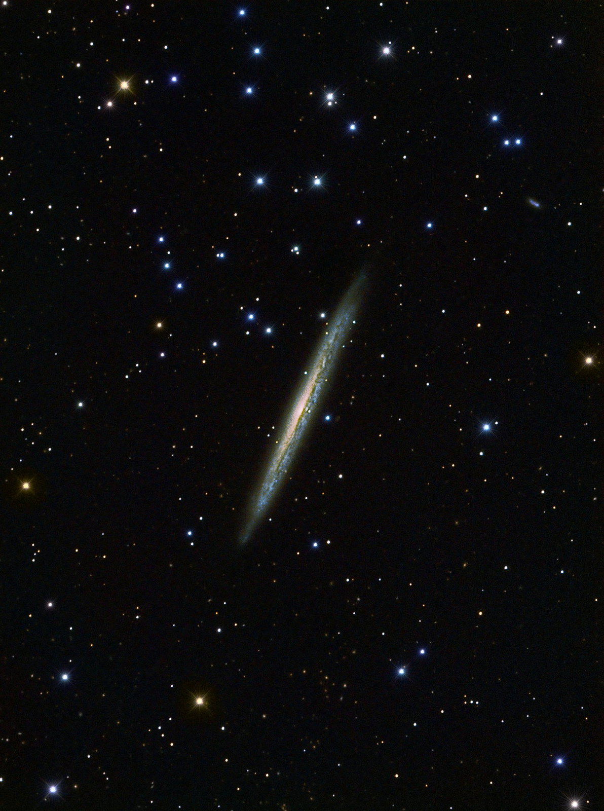 Ouch! Galaxy Cuts Like a Knife in Stunning Image