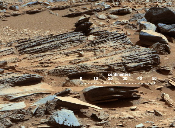 "This image from the Mast Camera (Mastcam) on NASA's Mars rover Curiosity shows inclined layering known as cross-bedding in an outcrop called ""Shaler"" on a scale of a few tenths of meters, or decimeters (1 decimeter is nearly 4 inches). Image released January 15, 2013."