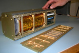 Sara Seager brought to the panel discussion a model of a lower-cost nanosatellite dedicated to exoplanet discovery.  This image reveals the inner workings of a standard nanosatellite.