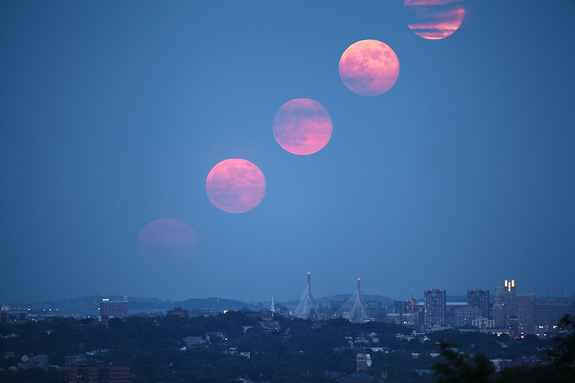 Experienced space photographers Edwin Aguirre and Imelda Joson created this composite view of the biggest full moon of 2013, a so-called 'supermoon,' from a series of images taken as the full moon rose over downtown Boston on June 23, 2013.