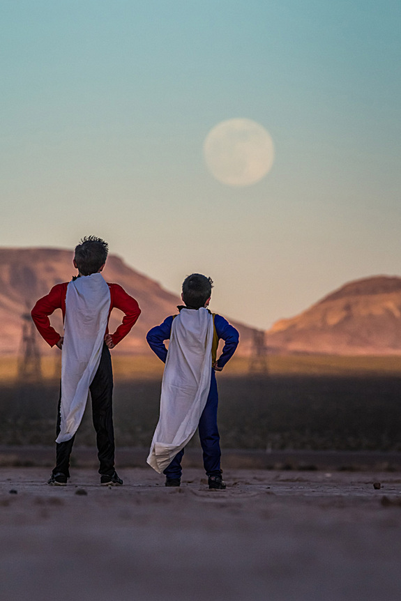 Astrophotographer Tyler S. Leavitt sent in a photo of kids dressed as superheroes watching the supermoon of June 23, 2013, outside Las Vegas, Nevada.
