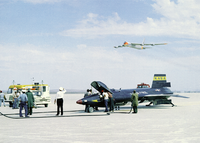 Space History Photo: X-15 on Lakebed with B-52 Mothership Flyover