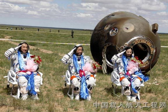 The crew of Shenzhou 10, China's fifth human spaceflight mission, salutes after a safe landing in inner Mongolia on the morning of June 26 local time in 2013. The crew is, from left: Zhang Xiaoguang, Shenzhou 10 commander Nie Haisheng and Wang Yaping, China's second female astronaut.