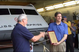 """Star Trek"" superfan Adam Schneider (right) receives a plaque from Hans Mikatis of Master Shipwrights, Inc., during the unveiling of the restored Galileo shuttlecraft on June 22, 2013. The Galileo was originally featured on the original ""Star Trek"" TV series in 1967 and restored by Schneider and his team."
