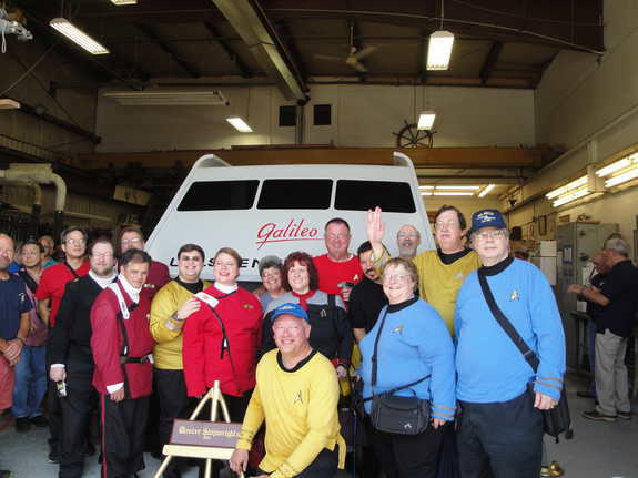"""Star Trek"" fans, including members of the U.S.S. Justice and U.S.S. Challenger fan groups, pose with the fully restored Galileo shuttlecraft from the original ""Star Trek"" TV series during an unveiling on June 22, 2013, at Master Shipwrights Inc., in Atlantic Highlands, N.J."