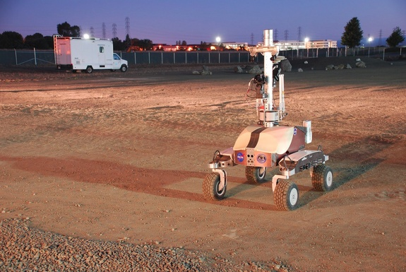 "NASA's K10 rover is seen at dawn at the Ames Research Center specially built ""Roverscape"" in Moffett Field, Calif. The rover was remote controlled by an astronaut on the International Space Station during a June 2013 technology test."